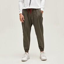 Pantalones con bolsillo fruncido