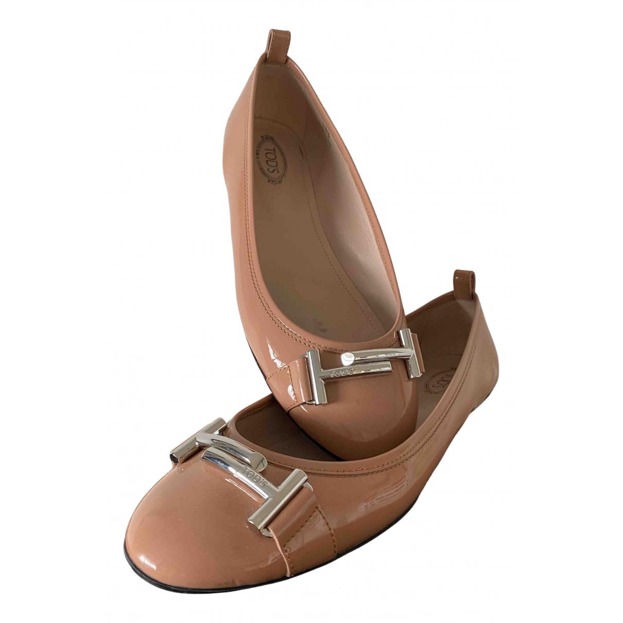 Tods - Ballerines   pour femme en cuir verni - rose