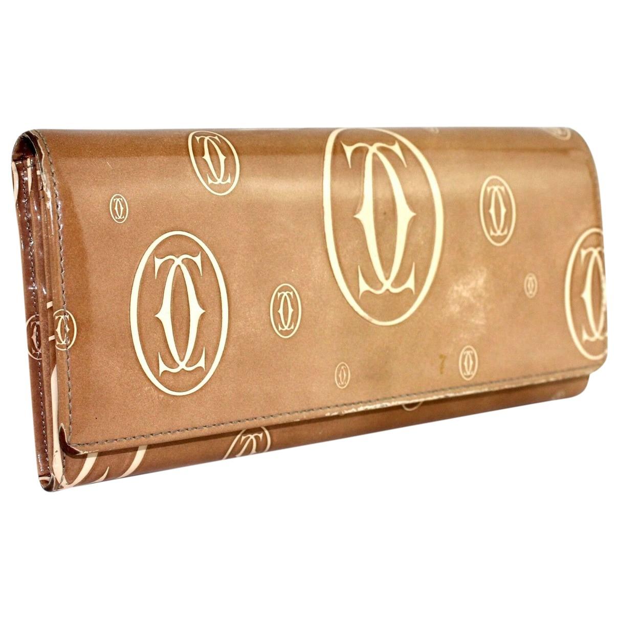 Cartier - Portefeuille   pour femme en cuir verni - camel