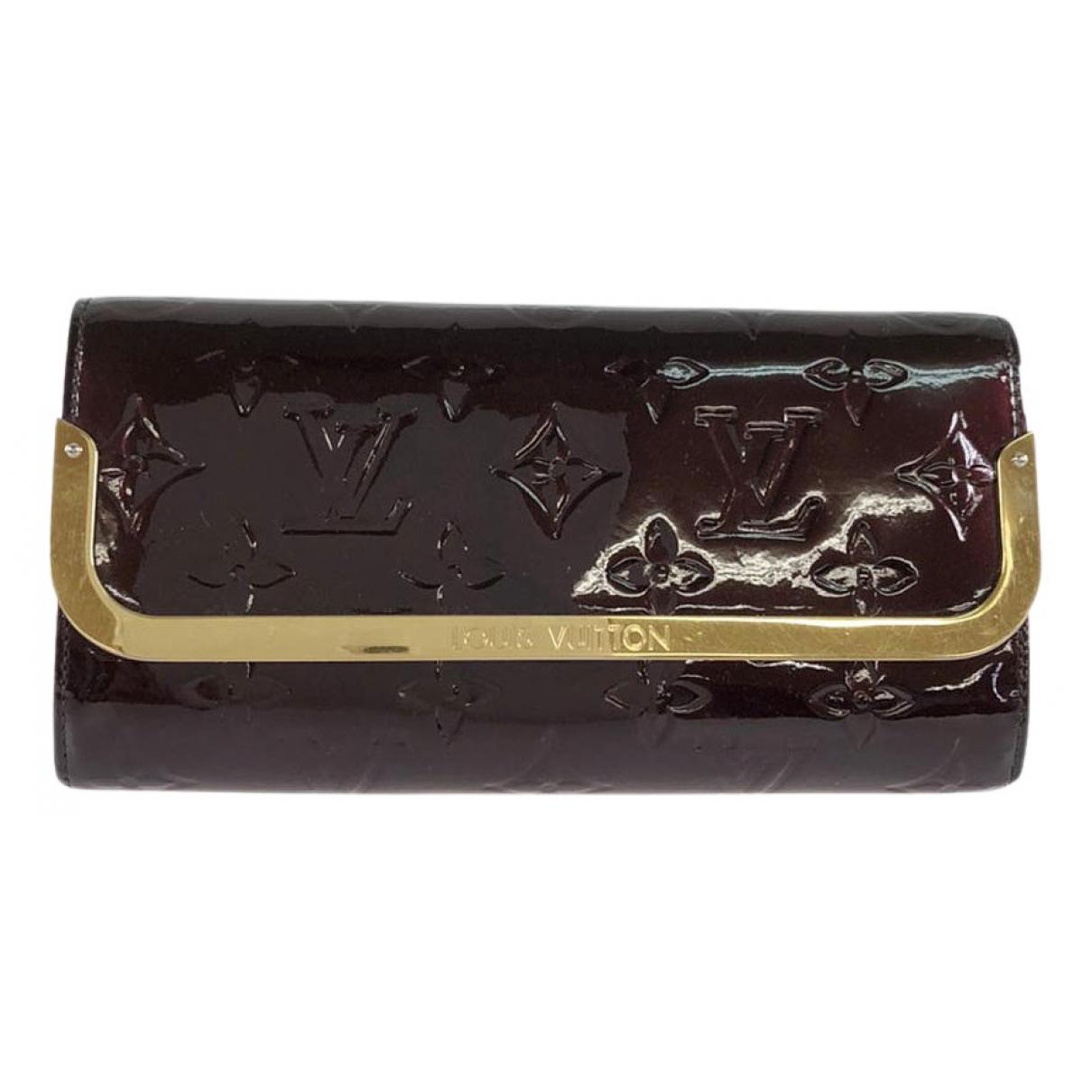 Louis Vuitton - Portefeuille   pour femme en cuir verni - bordeaux