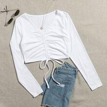 Camiseta corta fruncido con cordon delantero