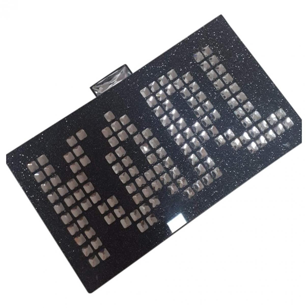 Bolsos clutch en Plastico Negro Karl