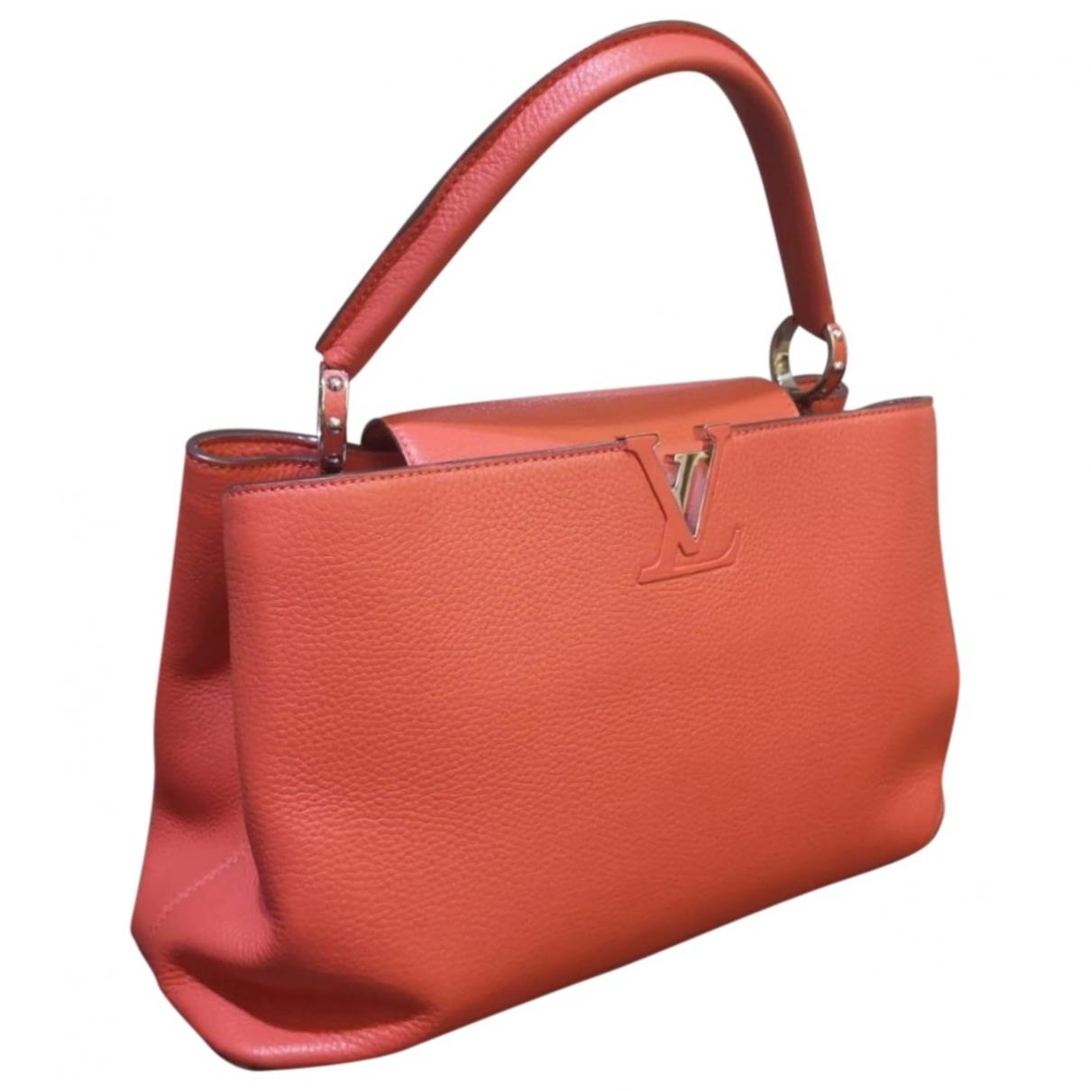 Louis Vuitton - Sac a main Capucines pour femme en cuir - rouge
