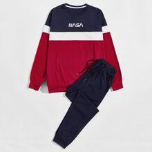 Pullover und Jogginghose mit Cut und Sew und Buchstaben Grafik