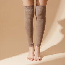 Calentador de pierna tejido