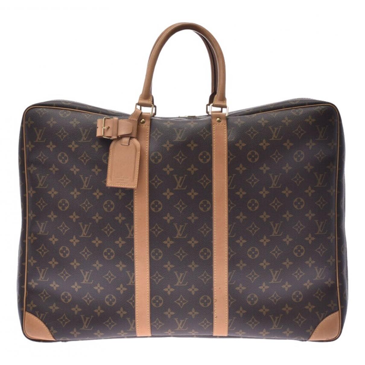 Louis Vuitton - Sac de voyage Sirius  pour femme en toile - marron