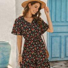 A Linie Kleid mit Blumen Muster und Schosschen am Saum