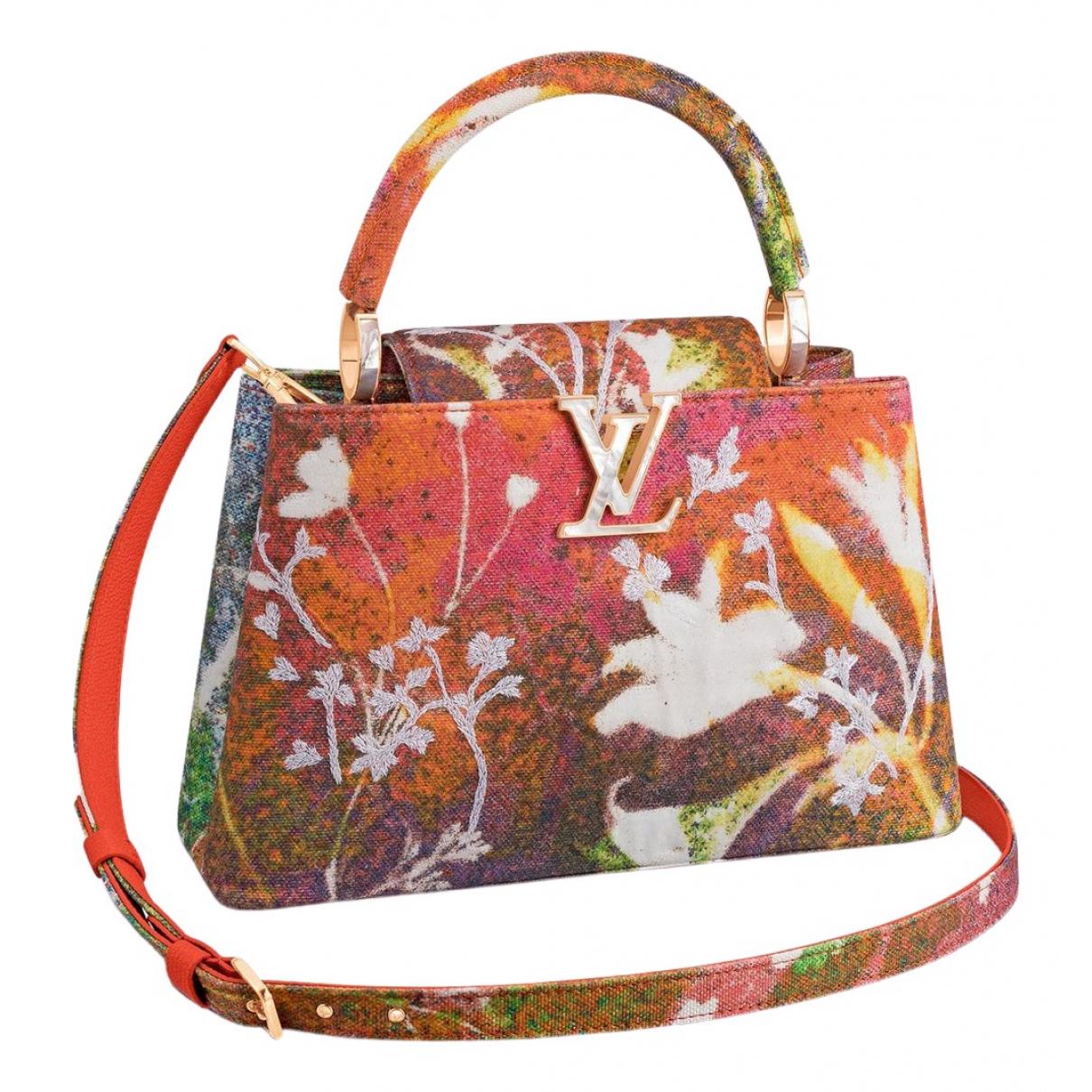 Louis Vuitton Capucines Orange Cloth handbag for Women \N