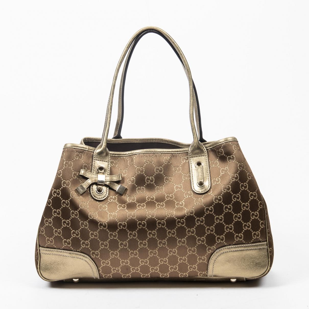 Gucci \N Handtasche in  Gold Baumwolle