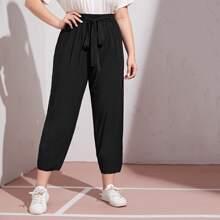 Pantalones unicolor con cinturon