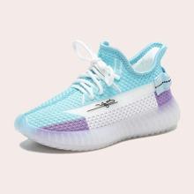 Zapatillas deportivas de color combinado con cordon