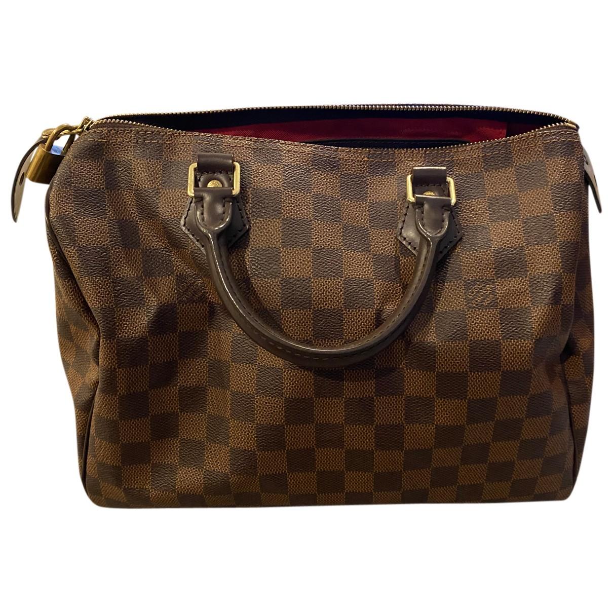 Louis Vuitton - Sac a main Speedy pour femme en cuir - marron