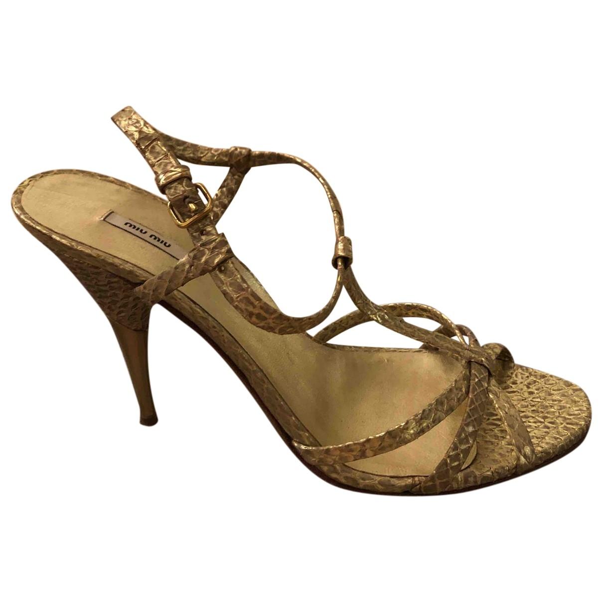 Miu Miu \N Gold Python Sandals for Women 37.5 EU