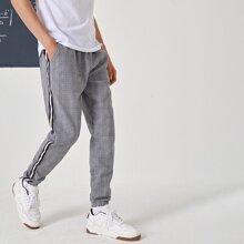 Pantalones de rayas de cuadros laterales