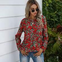 Bluse mit Blumen Muster und Rueschenbesatz