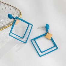 Zweifarbige Ohrringe mit Geo Dekor