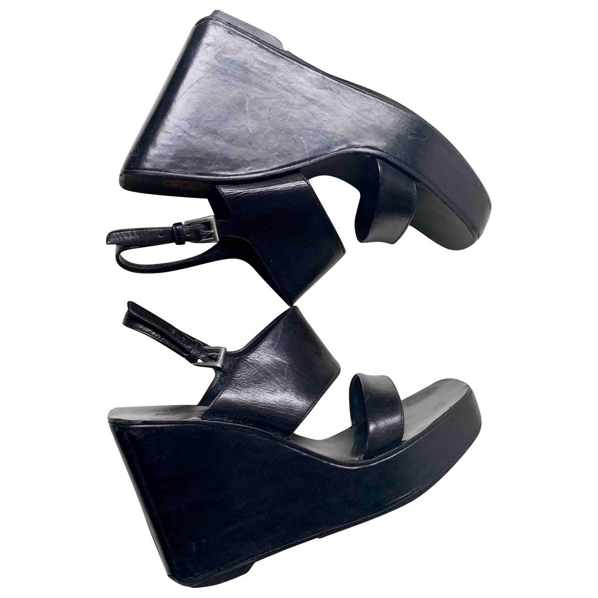 Prada - Sabots   pour femme en cuir - noir
