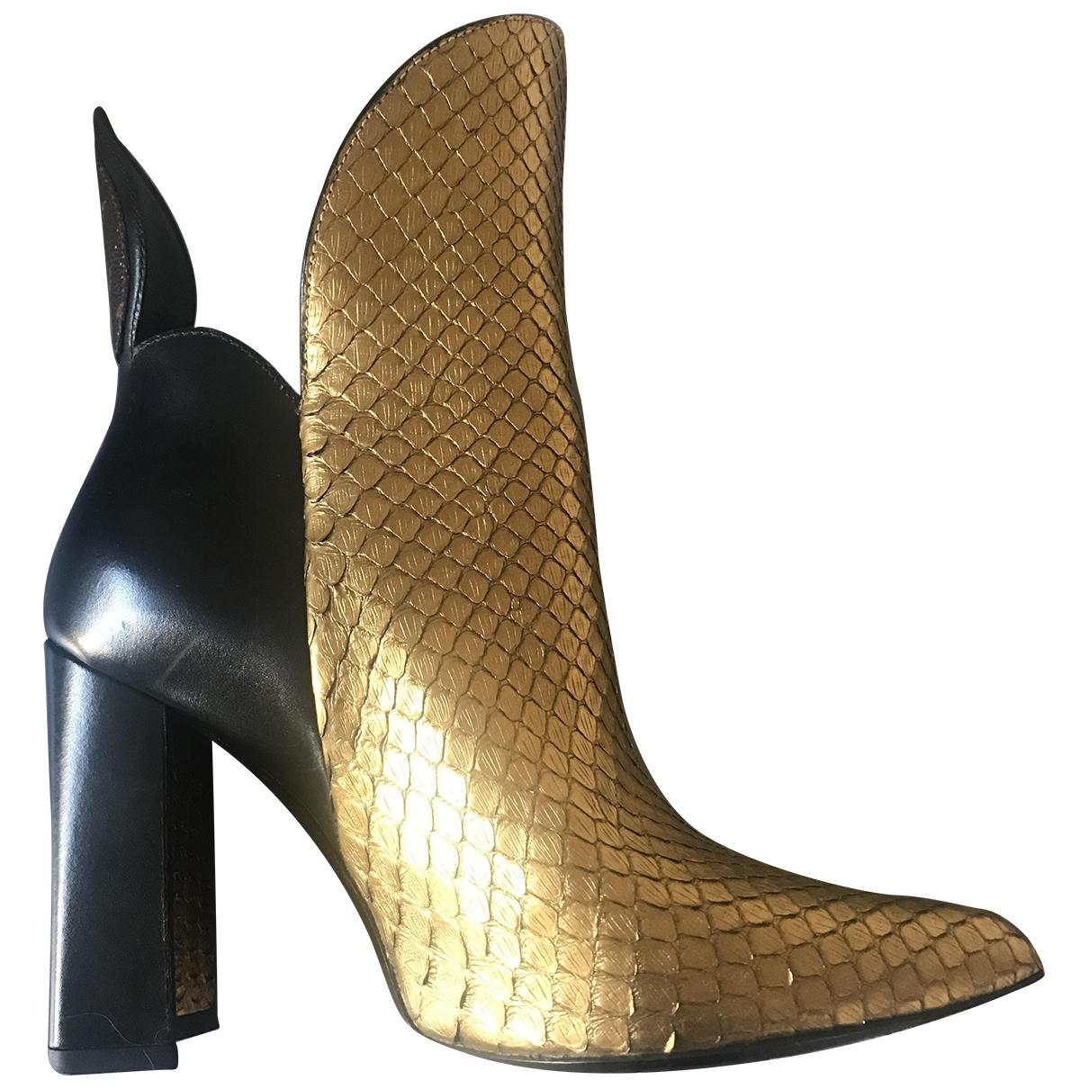 Louis Vuitton - Boots Matchmake pour femme en python - dore
