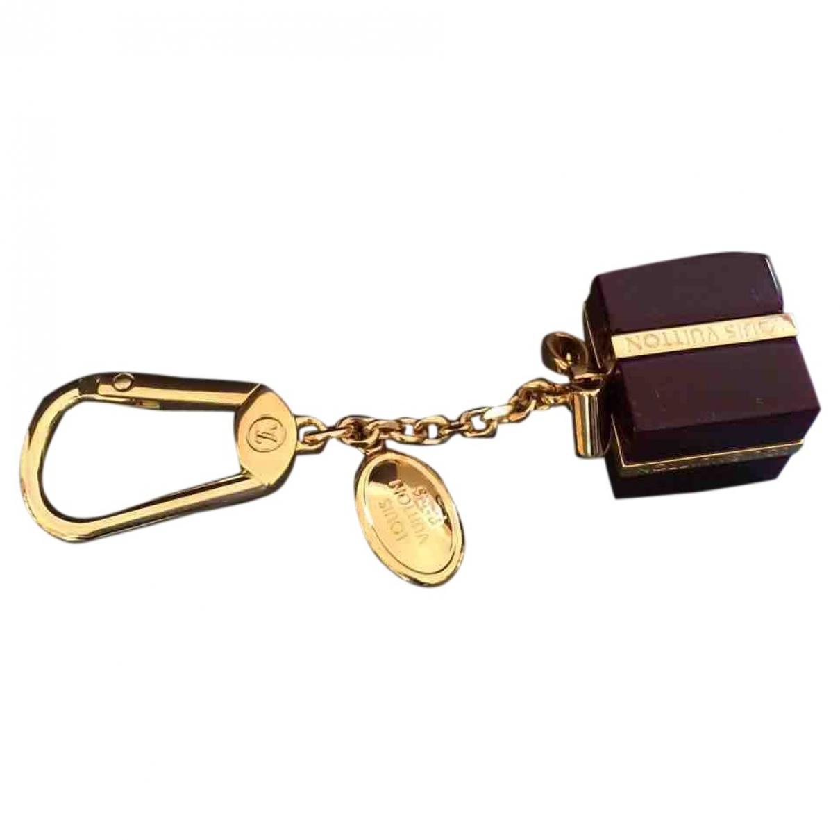 Louis Vuitton \N Taschenschmuck in  Gold Kunststoff