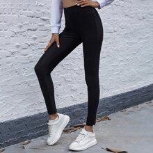 Einfarbige Leggings mit breitem Taillenband