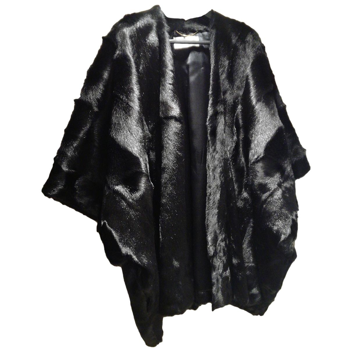 Saint Laurent - Manteau   pour femme en fourrure - noir