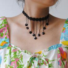 Halsband mit Quasten Dekor und Spitzen