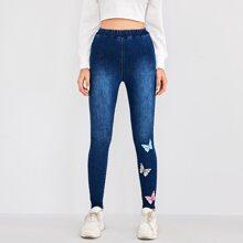 Skinny Jeans mit elastischer Taille und Schmetterling Muster