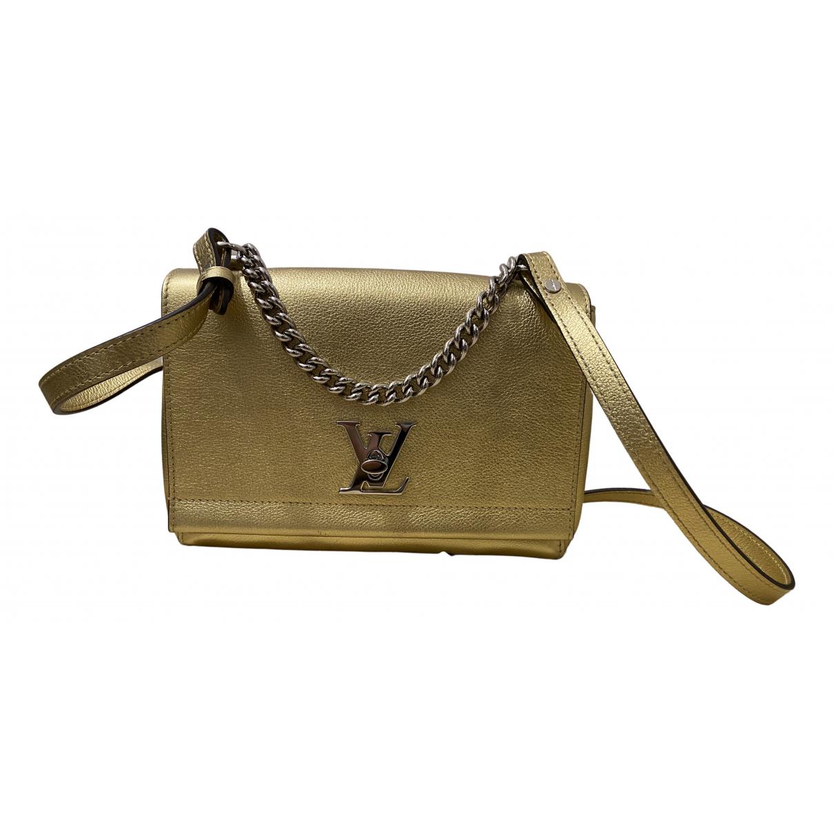 Louis Vuitton - Sac a main Lockme pour femme en cuir - dore