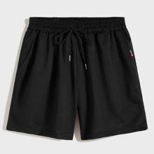 Shorts de hombres con cordon con parche