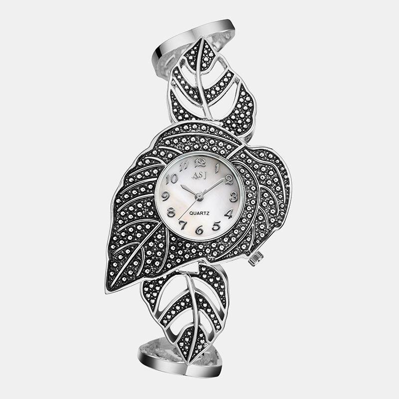 Creative Vintage Women Wristwatch Leaf-Shaped Titanium Silver Bracelets Quartz Watch