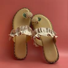Sandalias de dedo con piña