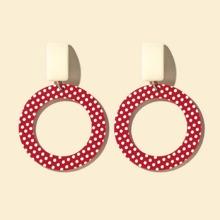 Runde Ohrringe mit Punkten Muster