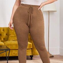 Texturierte schmale Hose mit Knoten vorn