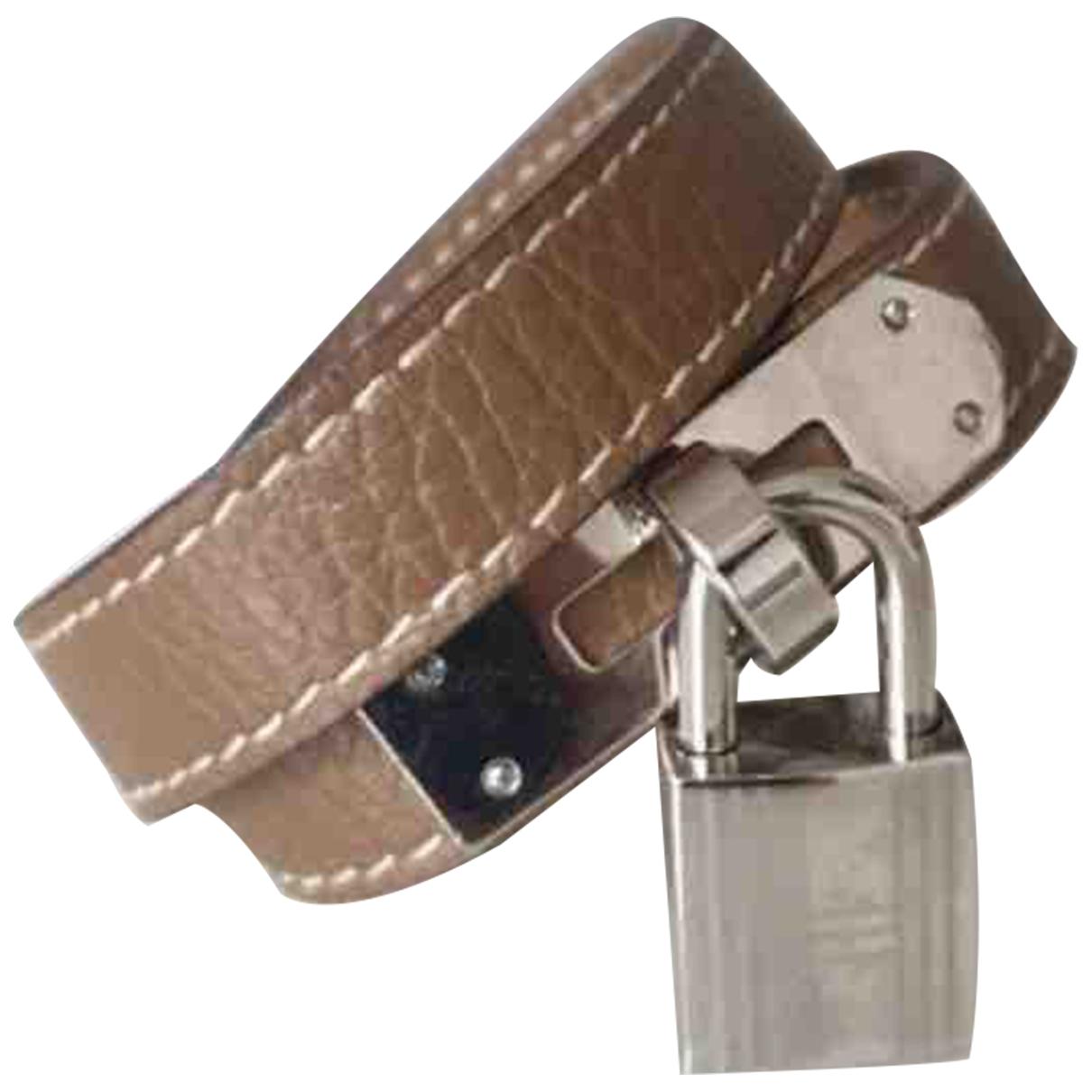 - Bracelet   pour femme en cuir - beige