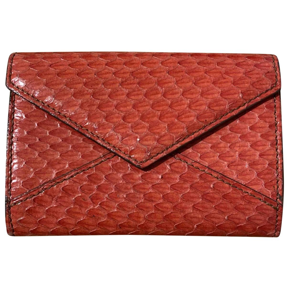 Cartier - Petite maroquinerie   pour femme en cuir exotique - rouge