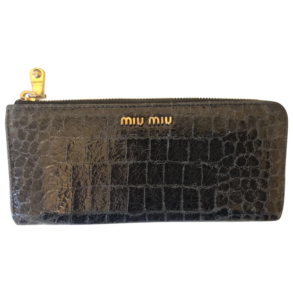 Miu Miu - Portefeuille   pour femme en cuir verni - noir