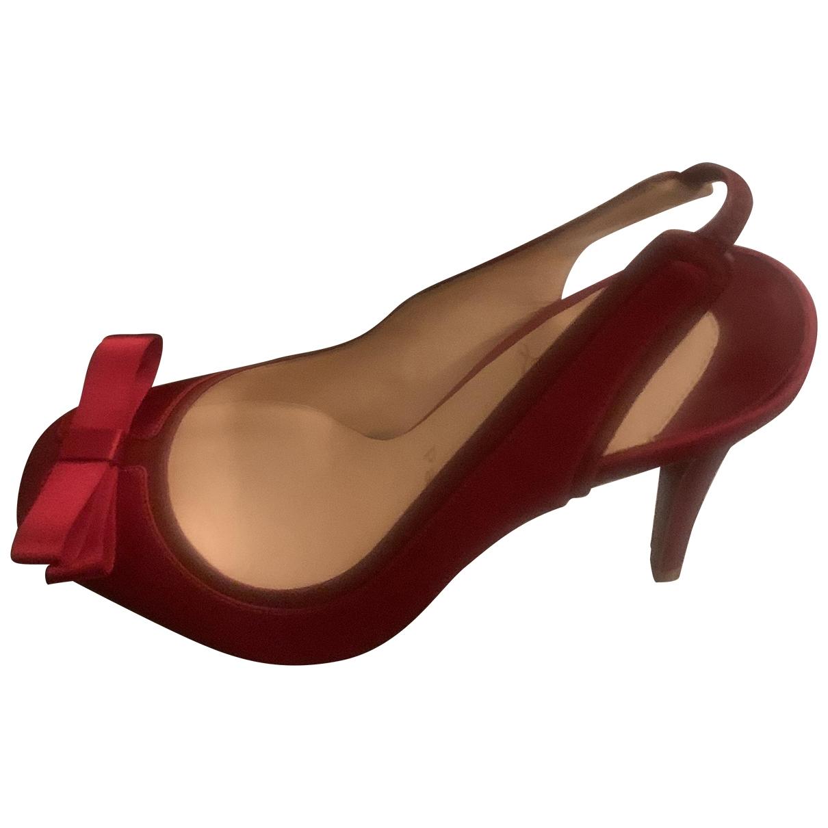 Christian Louboutin - Escarpins   pour femme en cuir - rouge