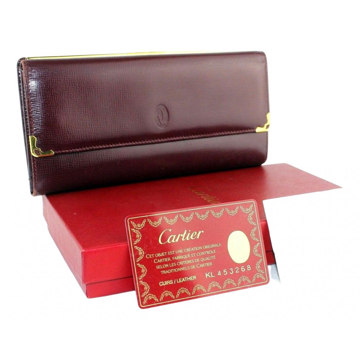 Cartier \N Portemonnaie in  Bordeauxrot Leder