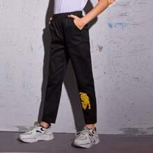 Pantalones con bolsillo oblicuo con estampado de leopardo