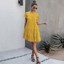 Kleid mit ueberallem Muster und Raffungsaum