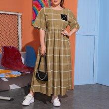 Kleid mit sehr tief angesetzter Schulterpartie, Taschen Flicken und Karo Muster