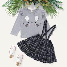 T-Shirt mit Karikatur Muster und Rock mit Karo Muster