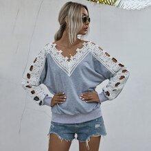 Pullover mit Kontrast Leiterausschnitt