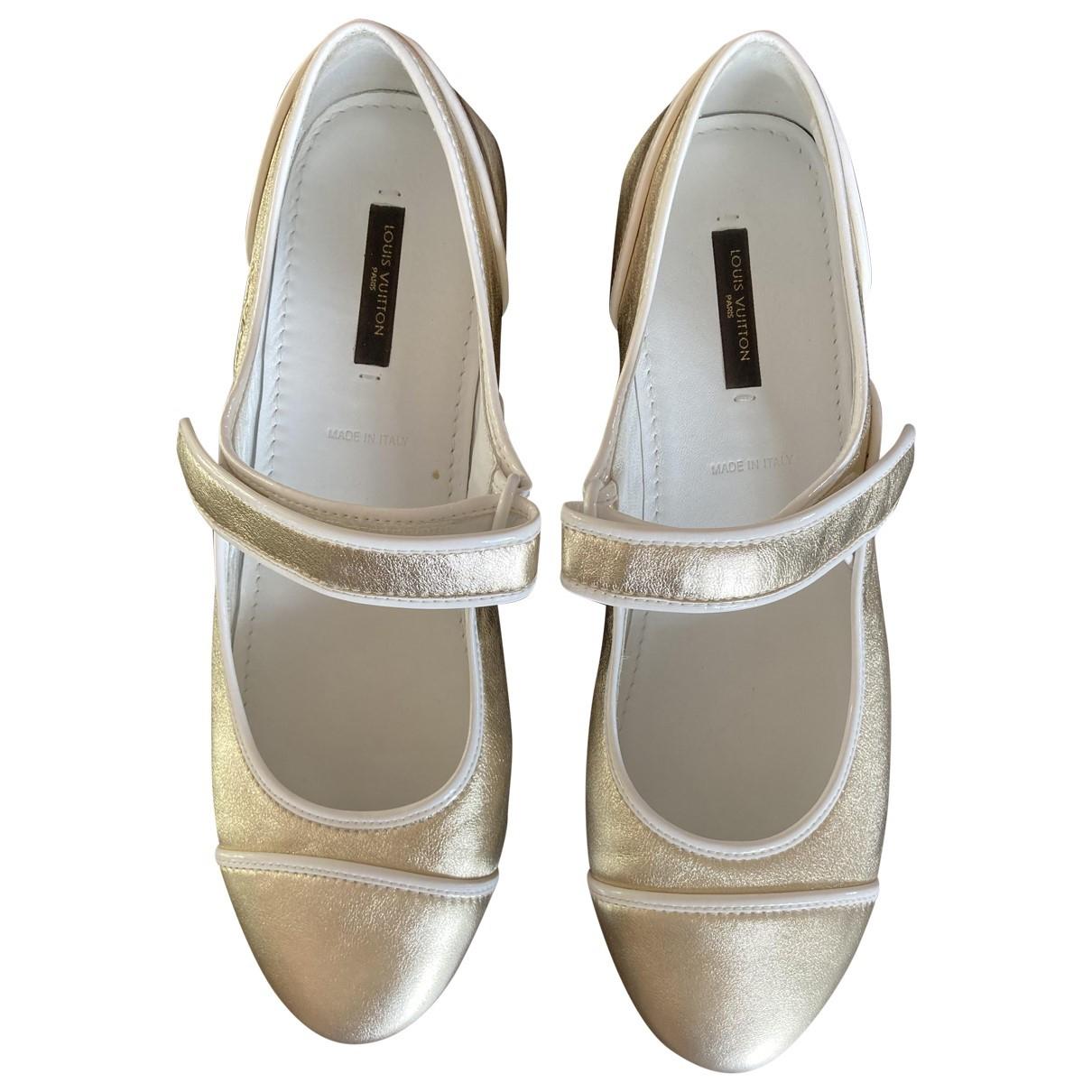 Louis Vuitton - Ballerines   pour femme en cuir verni - dore