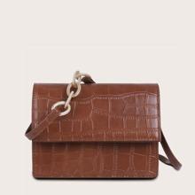Bolsa bandolera con solapa con diseño de cocodrilo