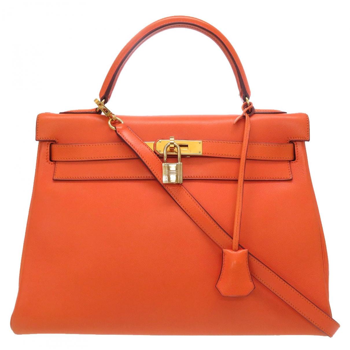 Hermès Kelly 32 Orange Leather handbag for Women \N