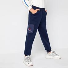 Jogginghose mit Buchstaben Stickereien und Taschen Klappe