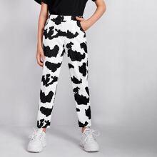 Pantalones con bolsillo oblicuo con estampado de vaca