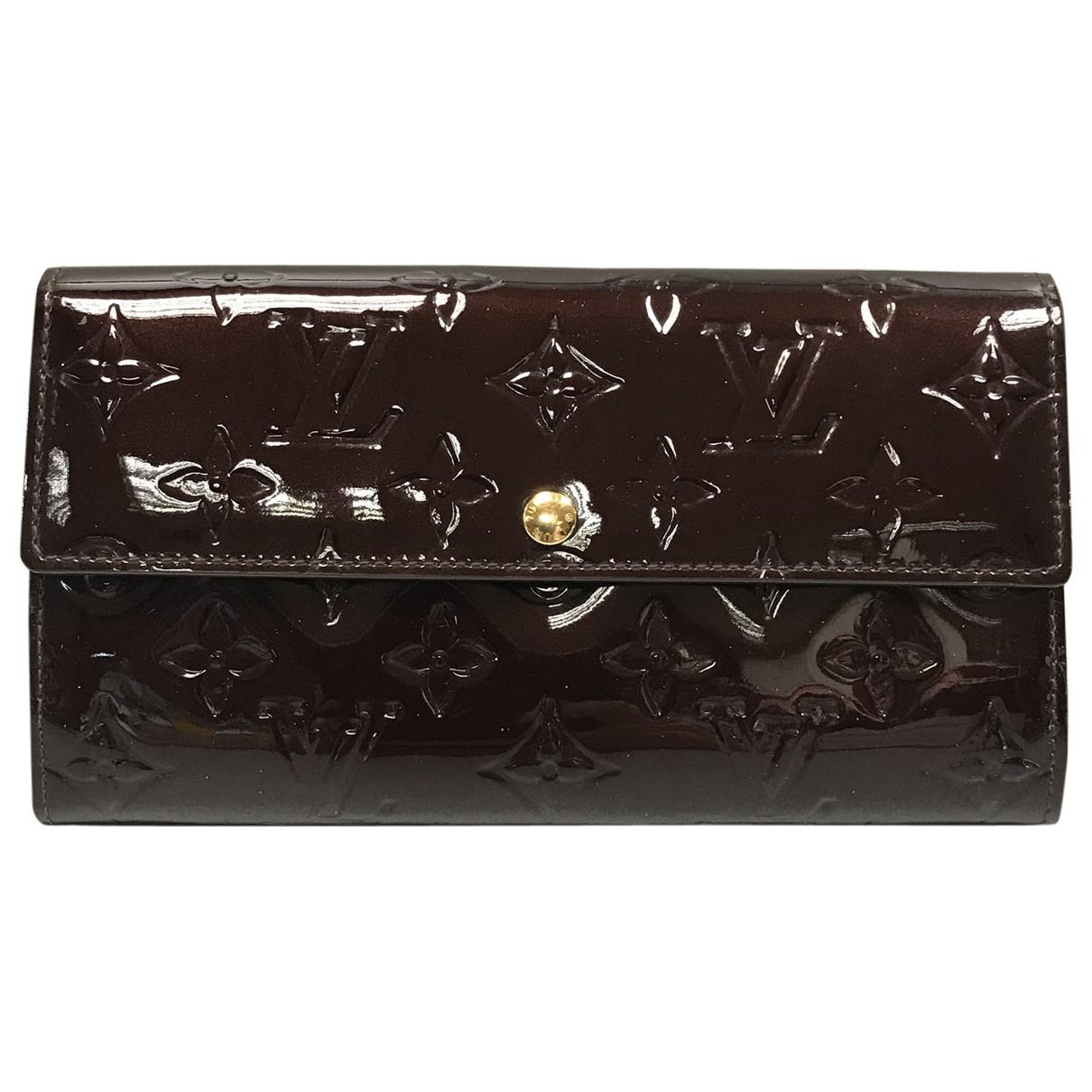 Louis Vuitton - Portefeuille Sarah pour femme en cuir verni - bordeaux