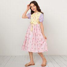 Vestido de color combinado con cordon delantero de manga farol con estampado floral de margarita